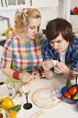 Couple preparing meat dumplings — Stock Photo