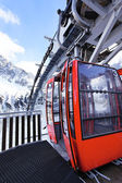 Red cable car in winter — Stock Photo