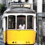 Tram in old Lisbon street — Stock Photo #12717843
