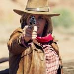 A gun in the hand — Stock Photo