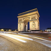 Arc de Triomphe by night with car lights — Stock Photo