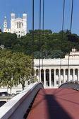 Lyon with red footbridge — Stock Photo