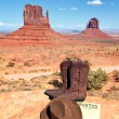 Boots and hat in front of Monument Valley — Stock Photo