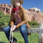 Blond woman wearing a cowboy hat — Stock Photo #16623515