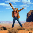 Cowgirl jumping at Monument Valley — Stock Photo
