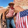 Cowgirl with american flag — Stock Photo