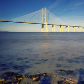 Evening on Vasco da Gama bridge — Stock Photo
