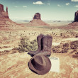 Stock Photo: Boots, hat and Monument Valley