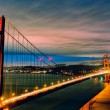 Foto Stock: Panoramic view of Golden Gate Bridge by night