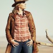 Beautiful blond cowgirl in the desert — Stock Photo