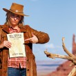 Panoramic view of bad cowgirl with wanted paper — Stock Photo