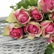 Some pink roses in Basket — Stock Photo