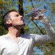 Drinking water in a park — Stock Photo #18442711