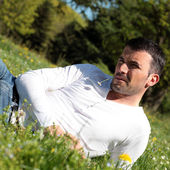 Handsome man with daisy — Stock Photo