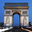 The famous Arc de Triomphe by night - Stock Photo