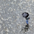 Man walking under the rain - Stock Photo