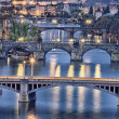 Famous Charles bridge at night - Stock Photo