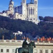 Famous statue and Fourviere basilic — Stock Photo #18689611