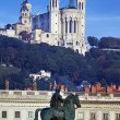 Famous statue and Fourviere basilic — Stock Photo