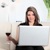 Computer and glass of red wine — Stock Photo