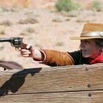 Woman with a gun — Stock Photo