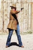 Bad girl with a gun — Stock Photo