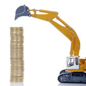 Coins with digger — Stock Photo