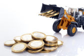 Coins and loader — Stock Photo