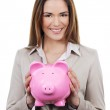 Woman with piggy bank — Stock Photo #19562473