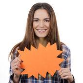 Woman holding orange panel — Stock Photo