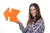 Kobieta pomarańczowy gospodarstwa strzałka — Zdjęcie stockowe