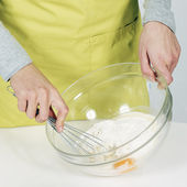 Whisking batter in kitchen — Stock Photo