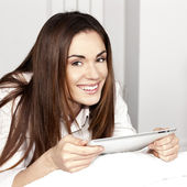 Beautiful smiling woman with tablet — Stock Photo