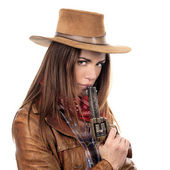 Attractive cowgirl with gun — Stock Photo