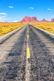 Long Road at Monument Valley — Stock Photo
