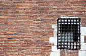 Prison red brick wall — Stock Photo