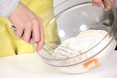 Woman whisking batter — Stock Photo
