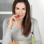 Beautiful girl eating healthy food — Stock Photo #23460444