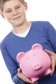 Boy with pink piggybank — Stock Photo