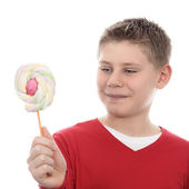 Boy looking at lollipop — Stock Photo