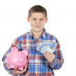 Cute boy with piggy bank and banknote — Stock Photo
