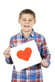 Drawn heart in boy hands — Stock Photo