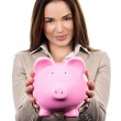 Cute woman with piggy bank — Stock Photo