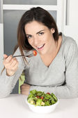 Beautiful young girl eating healthy food — Stock Photo