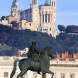 Statue and Fourviere basilic in Lyon — Stock Photo #25141133