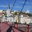 View of Lyon with red footbridge — Photo
