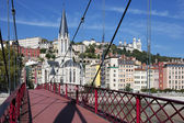 View of Lyon with red footbridge — Stock Photo
