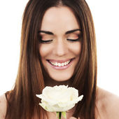 Cute woman with white rose — Stock Photo