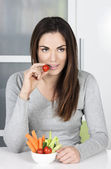 Cute girl eating healthy food — Stock Photo