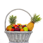 Ssorted fruits in wicker basket — Stock Photo